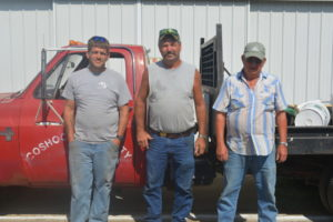 Three generations of the Conley family make sure the Coshocton County Fairgrounds is ready for fairgoers. Pictured from left are Lawrence Conley, John Conley and John Conley Sr. John is the current grounds superintendent at the fairgrounds and his father, who held the position before him, and his son Lawrence now both work for him.