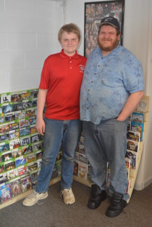 EJ Kreider is pictured with his father Kevin in their family's business, EJ's Video Game Exchange. The store opened in March in the mini plaza on Second Street. Josie Sellers | Beacon