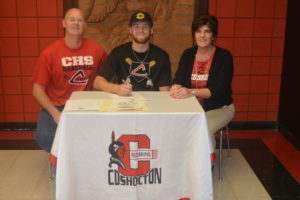 Andrew Mason, center, signed to play baseball at Ohio Dominican University. At left is his father Brent Mason and at right is his mother Beth Walsh. Mason is a senior at Coshocton High School and catches for the Redskins. Josie Sellers | Beacon