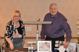 Ready to ring: Greg Fisher and Alison (Fisher) Flinner of the House of G. A. Fisher in Roscoe Village manned their display at the Bridal Fair held at Coshocton Village Inn & Suites on Saturday afternoon, March 7. Vendors included photographers, jewelry, catering, DJ services and others. Beacon photo by Mark Fortune