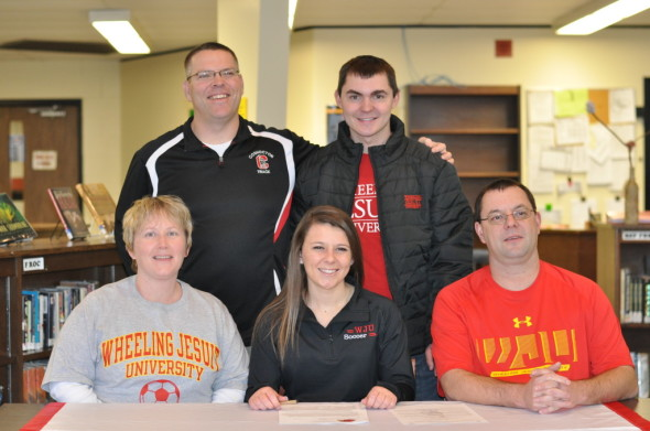 The Coshocton Redskins Emily Hartley (center) signed her national letter of intent to play college soccer at Division II Wheeling Jesuit University on Wednesday, Feb. 4 in the school library. Pictured left front, mom Mary, Hartley, dad and Redskins soccer coach Matt Hartley, Redskins Athletic Director Tim Fortney and Emily's brother Ian Hartley.