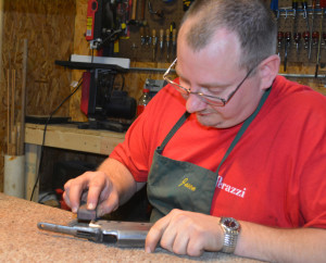 New business: Jason Basham is pictured prepping a gun for bluing. He and his wife Julie opened Diamond Point Gunsmithing in January. Beacon photo by Josie Sellers