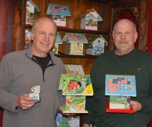 Books for art: Fred and Jim Williams make decorative Golden Book birdhouses out of Little Golden Books that their late father, Max Williams collected. Beacon photo by Josie Sellers