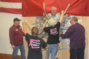 Dave Rogers at Annin kept a smile on his face through most of his time being duct taped to a plywood wall and having whipped cream pies thrown at him by employees. This was the company's unique way of raising money for United Way of Coshocton County.  Josie Sellers | Beacon