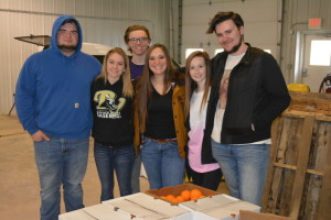 Volunteers: Seniors from River View High School pause for a picture while helping out at the Mid-Ohio Food Bank Community Mobile Market in Canal Lewisville. Pictured from left are: Dusty Erwin, Cassidy Thornsley, Allison Cramer, Bradley Conkling, Brittany Chaney and Shayne Foster. Beacon photo by Josie Sellers