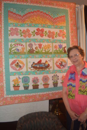 Mary Ann Lampe stands by her gardening quilt she made for the 2016 Coshocton Canal Quilters show.