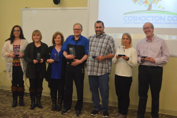 Several awards were presented at the annual Developmental Disabilities Awareness Luncheon held March 1 in the Frontier Power Community Room. Pictured from left are: Sydney McKee, youth advocate; Hollie Hendricks, distinguished service; Helen Lawrentz (representing Hopewell Industries, Inc.), volunteer of the year; Karl Murray, individual achievement; Dave Williams, support professional; Jennifer Andrews (representing Coshocton City Schools) and Scott Limburg (representing River View Local School District), partner of the year. Doug Patterson, who is not pictured, also accepted a partner of the year award for Ridgewood Local School District. Josie Sellers | Beacon