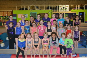 Congratulations: Flip-N-Out Gymnastics had 24 gymnasts and four competitive cheerleading squads qualify to compete at national meets. Many of the gymnasts also are on the cheerleading squads. Beacon photo by Josie Sellers