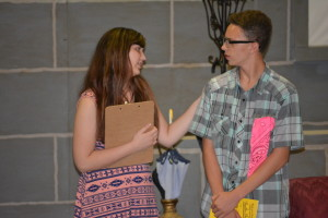 """Annie Bosson and Xavier Lewis practice a scene from """"Murder at The Goon Show.""""  Josie Sellers 
