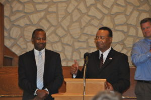 Dr. Ben Carson (left) is being introduced by Shiloh Missionary Baptist Church pastor Cliff Biggers prior to speaking to a full house at the church on Sunday afternoon, Oct. 30. Mark Fortune | Beacon