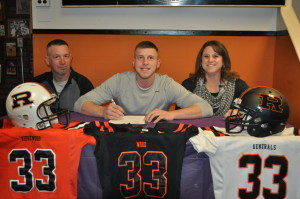 Signing: Tanner Shaw, a senior at Ridgewood High School, signed his letter of intent on Friday, Feb. 19 at Amici's Pizza in West Lafayette to play football at Cincinnati Christian University this fall. Family, friends and coaches were in attendance and watched as Shaw and Generals head football coach John Slusser signed the letter. This will be the first year for a football program at the college and the head coach will be former Bengals standout David Fulcher. Shaw is pictured with his dad, Scott and mom Tina. Beacon photo by Mark Fortune