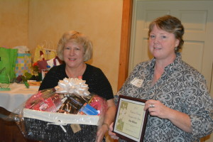 Honor: Pat Lake, caregiver education coordinator for AAA9, is pictured with Kimberly Wilson who was named the Coshocton County Caregiver of the Year during a luncheon held Oct. 9, at Raven's Glenn. Beacon photo by Josie Sellers