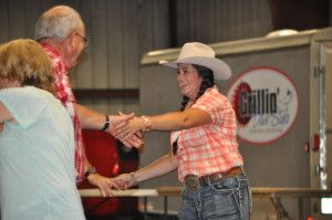 The first ever Celebrity Hoedown was held in Hunter Arena at the Coshocton County Fairgrounds on Friday evening, July 8. Jacque Woodward is pictured enjoying the square dancing. Mark Fortune | Beacon