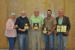 """Award winners gathered for a photo following the dinner. Pictured from left are MaryAnn and Jim Williamson, Community Persons of the Year Award; Bob Buxton, Life Service Award; Travis Mullett, First Year Lion Award; and Fred Wachtel, W.R. """"Dick"""" Bryan Award. Not pictured is Donald Smith, Lion of the Year Award. Mark Fortune 