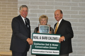 Award: Neal and Barb Caldwell received the 2015 Outstanding Conservation Farmer of the Year Award at the Coshocton Soil and Water Conservation District 73rd annual Banquet. Pictured from left are Adrian Garber, Coshocton SWCD Supervisor and Barb and Neal Caldwell. Beacon photo by Mark Fortune