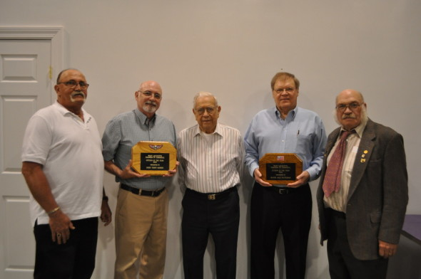 Awards presented: Former Mayor of West Lafayette Jack Patterson (fourth from left) was presented with the Citizen of the Year award at the annual West Lafayette Chamber of Commerce dinner held at the First Baptist Church in West Lafayette on Tuesday evening, April 26. Former Chief of Police Terry Mardis (second from left) was honored with a Meritorious Service plaque. Ed Chapdelaine, (far right) vice president of the chamber, presented the awards. The honorees were given a plaque, a print and a proclamation. West Lafayette Mayor Steve Bordenkircher also read a proclamation and presented it to the men on behalf of the village of West Lafayette. Also pictured is George Leech, (center) who will serve as the Grand Marshall of the Homecoming Parade on July 29 and West Lafayette Chamber President Oren Griffith (far left). Beacon photo by Mark Fortune