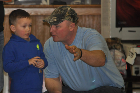 Keegan (left) and Nic Carey were enjoying themselves at the 28th annual Muskingum Valley Chapter of the NWTF Hunting Heritage banquet held March 4 at Lake Park Pavilion. One of the highlights of the evening is a gift to each youth age 17 and under. Nic is giving Keegan some fatherly advice on how the drawing works and some tips on selecting a prize. Mark Fortune | Beacon