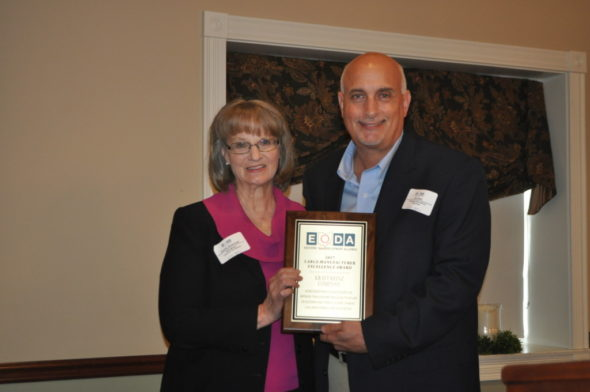Kurt Bain, Kraft Heinz Company Coshocton plant manager, is pictured with Dorothy Skowrunski, Coshocton Port Authority Executive Director, with the large manufacturer excellence award that was presented to Kraft Heinz at the 2017 Eastern Ohio Development Alliance annual meeting on Friday, April 28. The meeting was held at the Carlisle Inn in Walnut Creek.