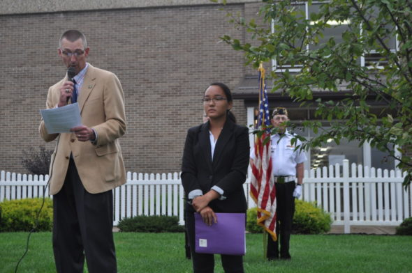 River View High School Principal Chuck Rinkes speaks at the Friday, Sept. 9 ceremony observing the 15th anniversary of the Sept. 11, 2001 terrorist attacks on America. Senior students attended the ceremony and gathered in a semi-circle around a flowering crab tree that was planted at the school to observe the 10th anniversary. Rinkes is pictured with Aselya Sposato, who organized the event and Jerry Green, a member of the Coshocton County Veterans Council Honor Guard.