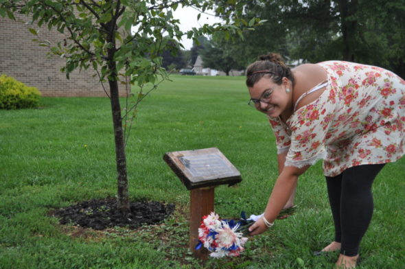 River View student Audree Murray placed a bouquet of flowers at a flowering crab tree during a special observance held Friday morning, Sept. 9 for the 15th anniversary of the Sept. 11, 2001 attacks on America. The tree was planted in 2011 by the AP Government class to commemorate the tenth anniversary of the Sept. 11, 2001 attacks on America.