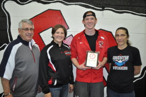 Award: Coshocton Redskins senior Bryce Philabaum was named the ECOL Swimmer of the Year at the ECOL Swim Meet held Friday evening, Jan. 15 at Coshocton. Pictured from left are: ECOL Commissioner Ron Tisko, Redskins Assistant Swim Coach Cari Weaver, Philabaum and Redskins Head Swim Coach Julia Shaw. Beacon photo by Mark Fortune