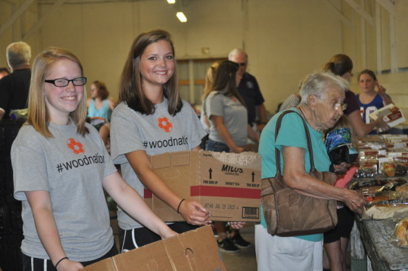 Members of the Ridgewood Generals girls' soccer team joined the Coshocton Kiwanis Club on Wednesday, July 29 to help distribute food and produce items from the Mid-Ohio Food Bank at the fairgrounds. Pictured left to right are juniors Breann Asbury and Mallory Simmons helping Twila Krieger at the event. Ten year old Kylah Patterson is also pictured helping. Members of the Ridgewood Generals girls' soccer team generously devoted their time to helping keep the Food Bank running smooth and sound.