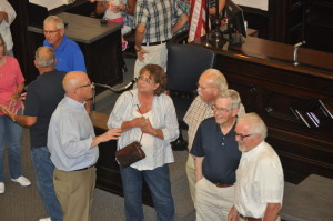 OPEN HOUSE: Judge Robert Batchelor talks with area residents about the renovation process in the Coshocton County Courthouse during the open house on Saturday, Aug. 1. BEACON PHOTO BY MARK FORTUNE