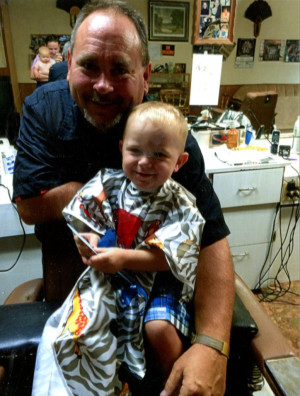 Bob Davis, the owner of Bogey's Barber Shop, is pictured with his grandson J. D. Fowler, who was his first customer when he opened the doors. The business is in the same location as the former McKee's Barber Shop at 127 North Third Street in Coshocton.