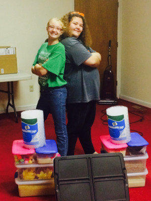 SENSORY BOXES: Kelsi Reynolds, left, and Jadn Lindig, right, pose with their sensory boxes they made for two local health and rehabilitation centers, the 311 Building and Three Rivers Therapy. The two completed the project for their Bronze Award in Girl Scouts. PHOTO CONTRIBUTED TO THE BEACON