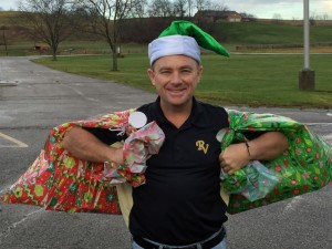 SANTA'S HELPER: Assistant Principal at River View Junior High School Brad Baker delivers presents to River View families in need this Christmas season. Through funds raised by teachers and in the community, the school was able to help 10 local families this year. PHOTO CONTRIBUTED TO THE BEACON