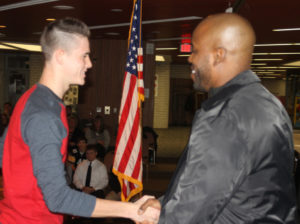 Ashton Jarvis shakes Cie Grant's hand during a recognition dinner held Dec. 4 at the Coshocton County Career Center for senior football players from all three county high schools. Josie Sellers | Beacon
