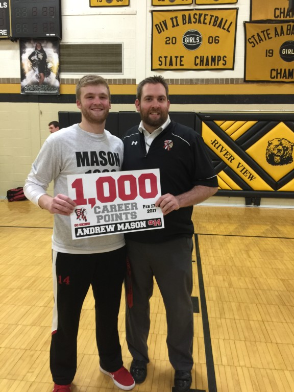 CHS senior Andrew Mason (left) celebrated scoring 1,000 career points with his Coach Jeremy Ady. Mason reached the milestone during his teams win over River View on Feb. 17.