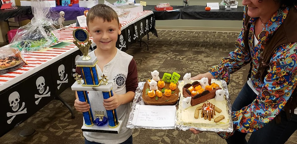 Jake Guilliams and cake trophy