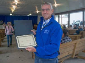 """John McDonald, building supervisor at the Coshocton campus, accepts """"Planting Pride in Coshocton"""" award at Coshocton County Fair on Oct. 3."""