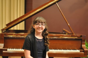 Julia Grimmett won the junior division of the Edward E. Montgomery Jr. Piano Competition held Sunday evening, April 2 at the Triple Locks Theater in Roscoe Village.  Mark Fortune | Beacon