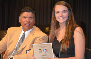 Award: Anthony Munoz, who played 13 seasons with the Cincinnati Bengals and was inducted into the Pro Football Hall of Fame in 1998, presented River View High School senior Lydia Els with an award for being named one of 20 high school athlete finalists for the U.S. Army-Pro Football Hall of Fame Award for Excellence. The presentation took place at the end of the school's May 18 awards ceremony. Beacon photo by Josie Sellers