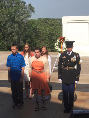 Pictured at a wreath laying ceremony at the Tomb of the Unknown Soldier in Washington D.C. are Alex Haarman, Jenia Gump, Emma Merryman and Taylor Keffer.  The Ridgewood High School students were taking part in their eighth grade class trip to D.C. and were selected through an essay process to take part in the ceremony.  Contributed | Beacon