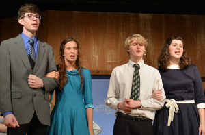 "Show time: Nick Blakley, Veronica Roberts, Connor Wheeler and Danika Brenneman are pictured practicing a scene from ""White Christmas."" The four Ridgewood High School seniors are part of the production that will be performed April 1-3, at the high school. Beacon photo by Josie Sellers"