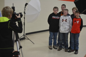 Photography: John Thompson (far left) snaps a photo of his classmates with the help of Judd Bone from Claxon Communications, who is not pictured. Thompson and his fellow sixth graders at Ridgewood Middle School participated in a career day on March 7. Beacon photo by Josie Sellers