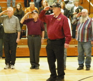 Retired and active military salute the flag during the National Anthem at River View High School as part of a ceremony honoring all active and retired military personnel. Jen Jones | Beacon