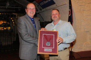 Award: Ohio Department of Agriculture Director David T. Daniels (left) presents the Director's Choice Award to Beau Guilliams of Raven's Glenn Winery for their red wine, 2013 Raven's Glenn R2 Noiret. Photo contributed to The Beacon
