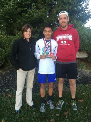 River View's Javin Robinson (middle) placed first in the junior high boys' cross country meet Oct. 23 at Hilliard Bradley High School. He is pictured here with River View's high school cross country coach Gwenna Neal and junior high coach Dennis Wilson. Contributed | Beacon