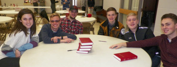A group of friends wait for the youth rally to begin at Roscoe UMC on March 19. Jen Jones | Beacon