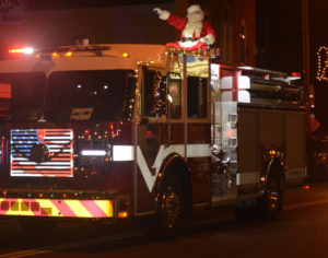 Santa rode into town on top of a Walhonding Valley Fire District truck on Nov. 27 so he could meet with all the girls and boys who had gathered for the Warsaw Candlelighting. Josie Sellers | Beacon