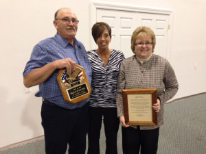 Award: Emily Bradford presenting the Citizens of the Year award to her parents, Oren and Patty Griffith at the West Lafayette Chamber of Commerce annual meeting and dinner. Pictured from left are Oren, Bradford and Patty. Beacon photo by Nancy Fortune
