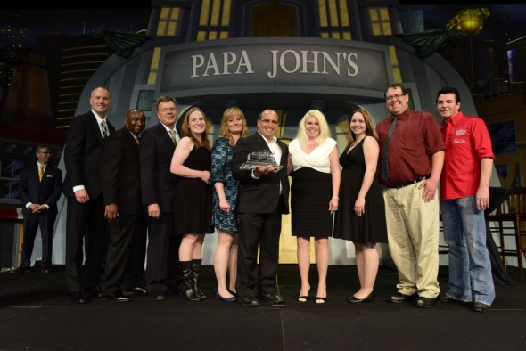 The local Papa John's received the Franchise of the Year award at the annual conference last April. Standing proudly with their award are owners Joe and Jenifer Hogue along with local managers, Jeannie Bruce, South Zanesville GM, Debbie DeVore, Uhrichville GM, Jessica Angles, North Zanesville GM, and Noah Gallagher, Coshocton GM.