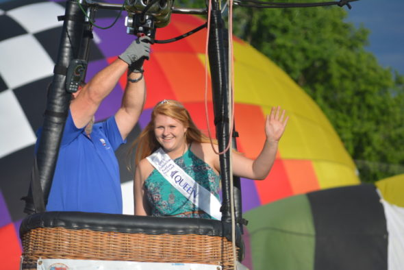 Josey Lillibridge, the 2017 Coshocton Hot Air Balloon Festival Queen, waves as she prepares to take a tethered balloon ride on June 8. The tethered rides were part of the fun at the festival, which was held June 8-10 at the Coshocton County Fairgrounds. Josie Sellers | Beacon
