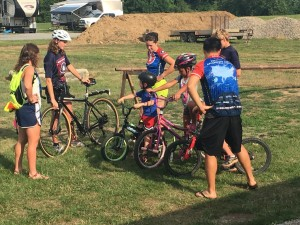 Children learn about the various parts of a bicycle during a safety presentation put on by Bike and Build at Colonial Campground on Thursday, July 7. Andrew Everhart   Beacon