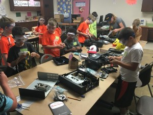 Kids let their creative juices flow as they disassemble computer towers and create their own unique inventions at Camp Invention on Wednesday, June 22.  Andrew Everhart | Beacon