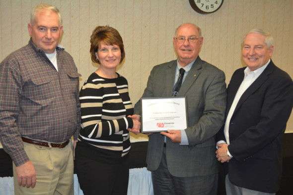 The Coshocton Grain Co. was presented with a Community Improvement Award at the Coshocton County Chamber of Commerce Quarterly Luncheon held Jan. 28 at Coshocton Hospital. Pictured from left are: Ron Warnock, operations manager at the Grain Co.; Rhoda Crown, CEO at the Grain Co.; Bill Owens, chamber board member; and Larry Endsley, board president for the Grain Co. For more photos from the luncheon, visit www.coshoctonbeacontoday.com